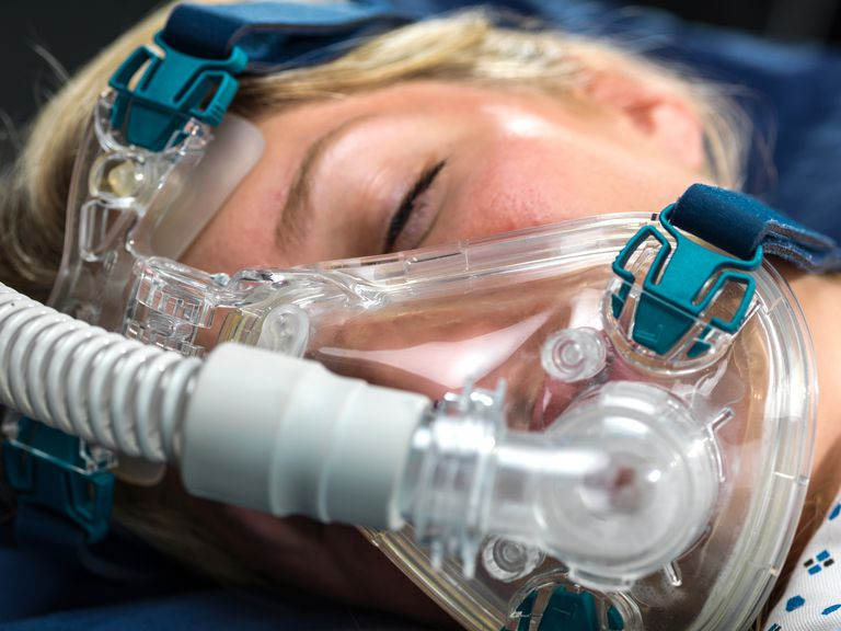 low priced dffc6 011bc Close-up of a woman wearing a CPAP mask for sleep apnea.