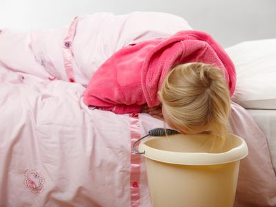 A girl vomiting