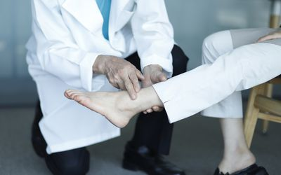 doctor checking navicular bone