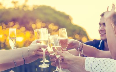 Group of friends drinking champagne