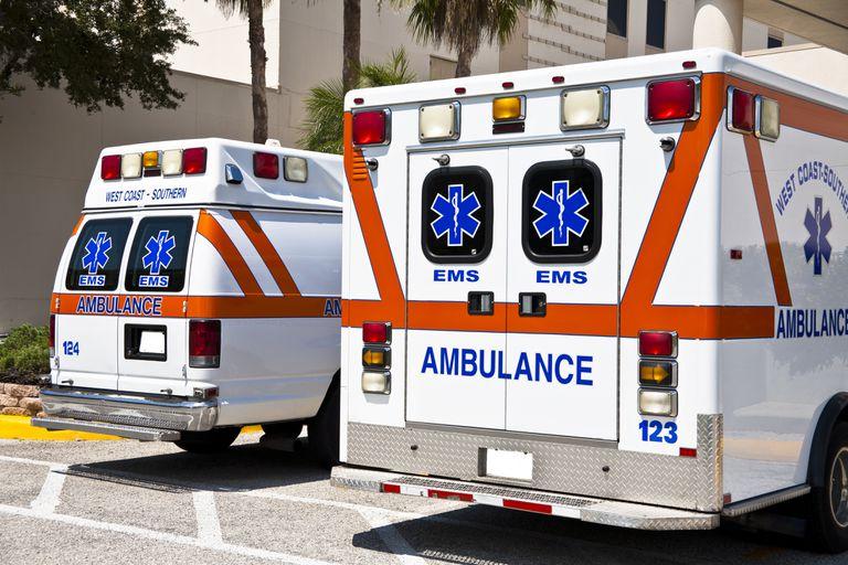 Two ambulance EMS vehicles