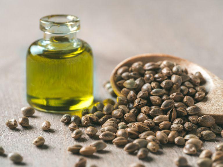 Closeup of hemp seeds and hempseed oil