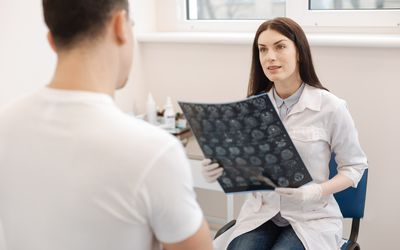 doctor with scans talking to a patient