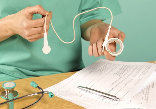 Surgeon Holding Gastric Band