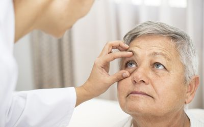 Doctor checking patient's eye