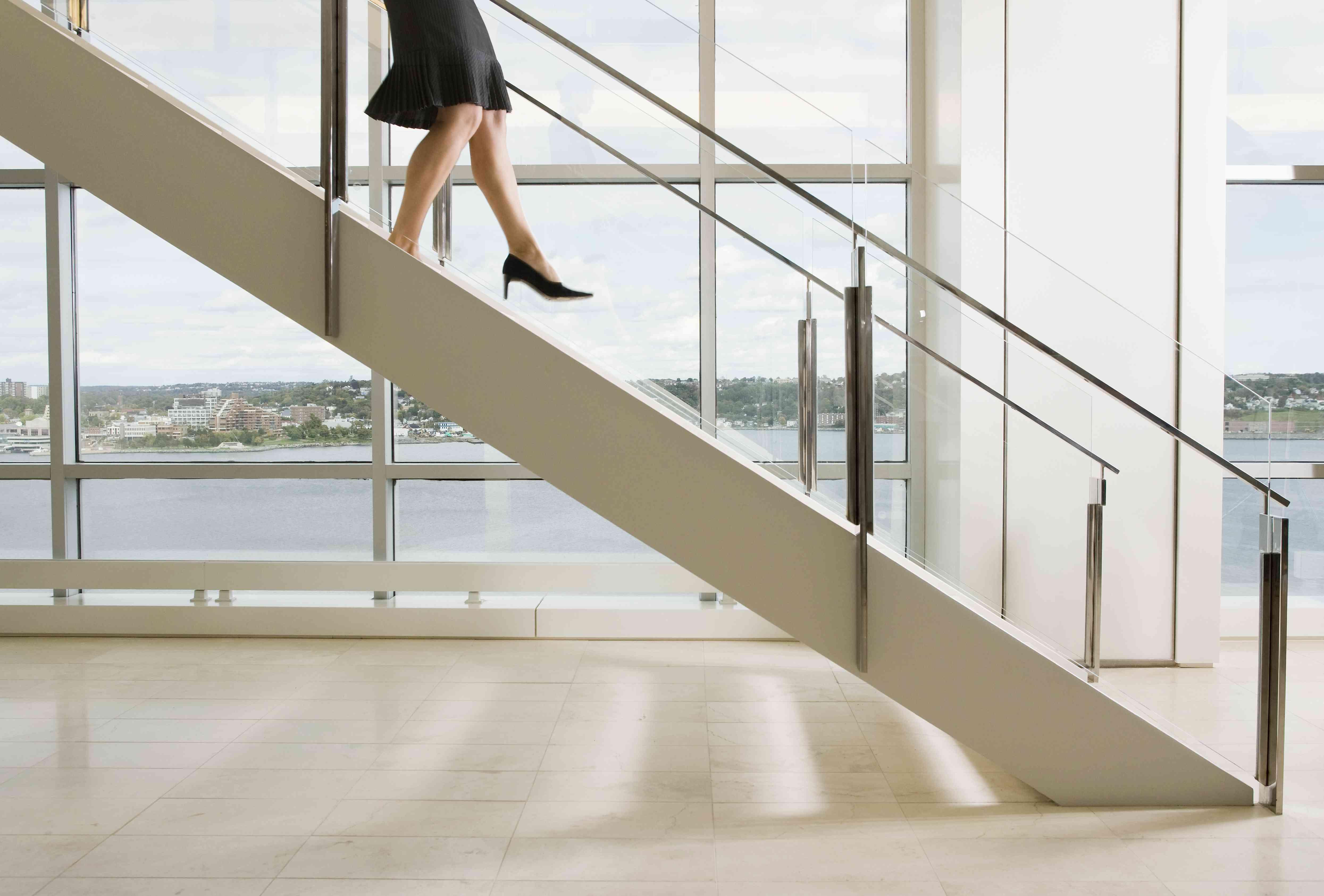 A woman walking down a staircase