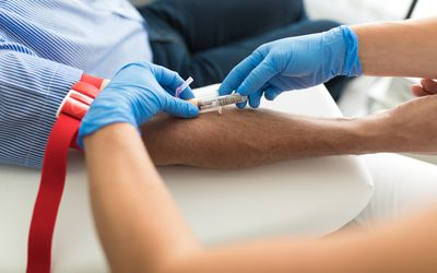 Senior man having a blood test done by a nurse