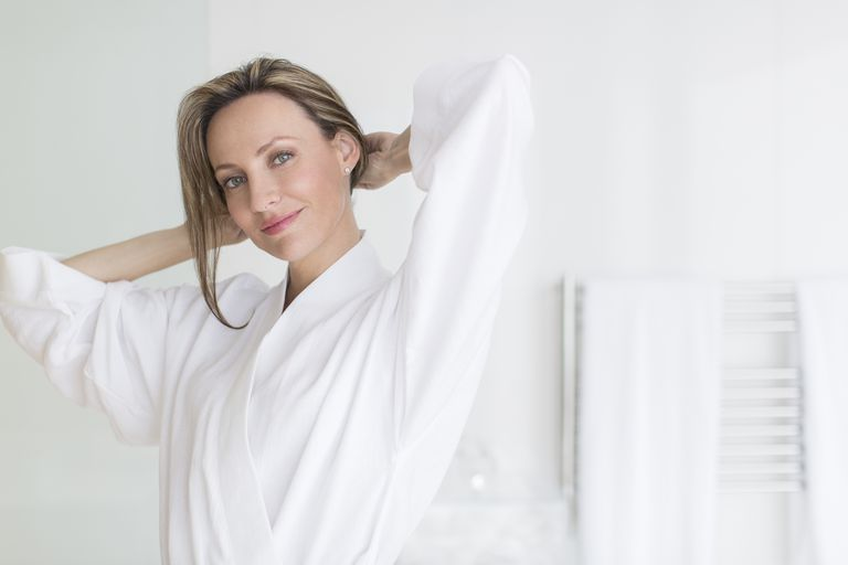 Smiling woman wearing bathrobe