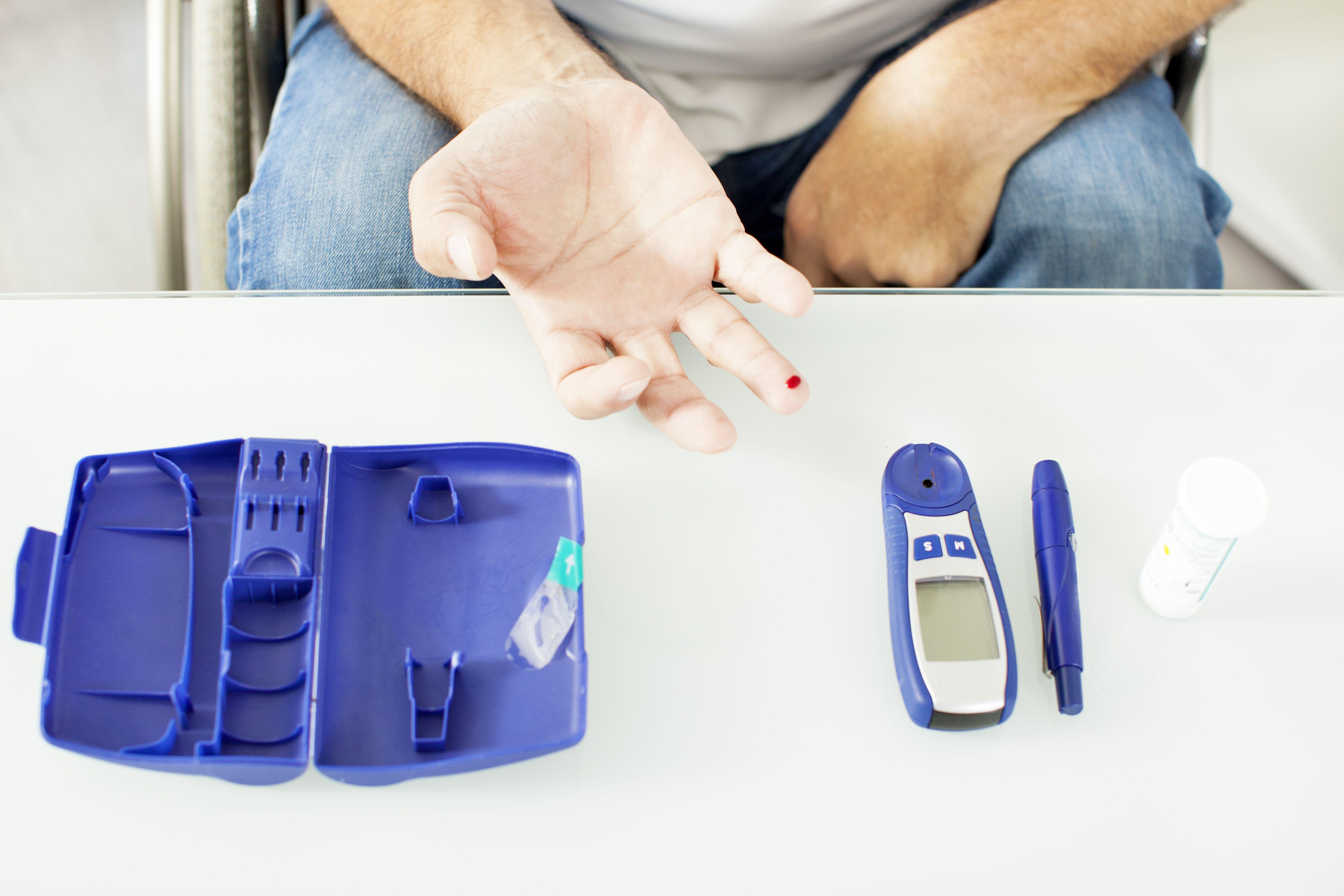 Senior Doing Blood Sugar Test