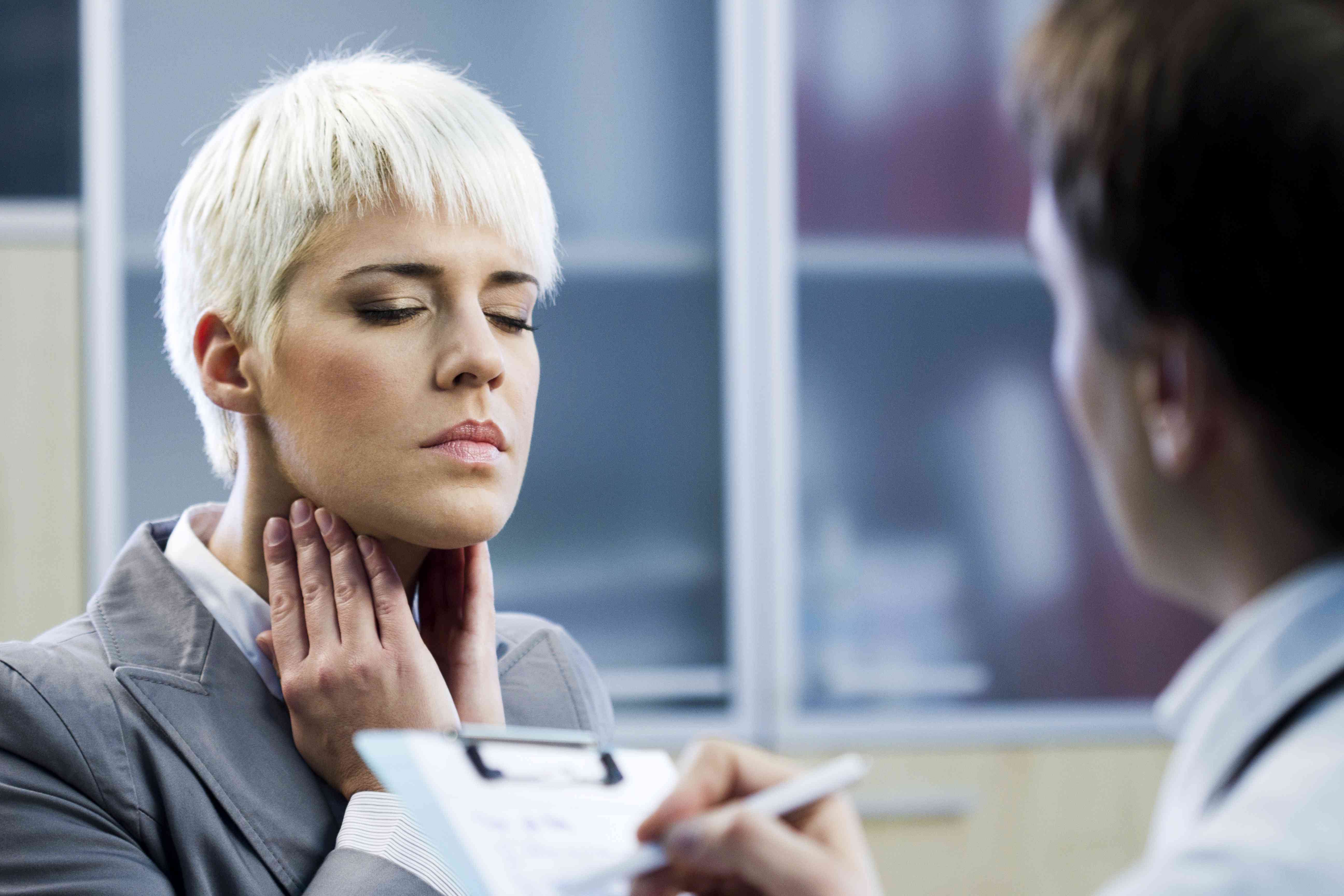 Young woman with sore throat