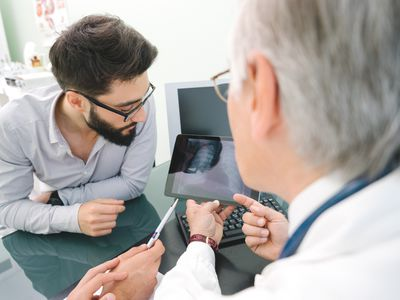 Man looking at lung imaging with his doctor