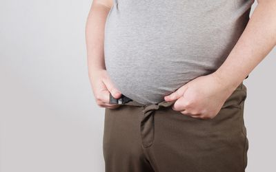 idsection Of Overweight Man Against White Background