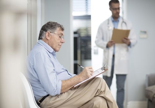 Patient filling out paperwork in a medical practice