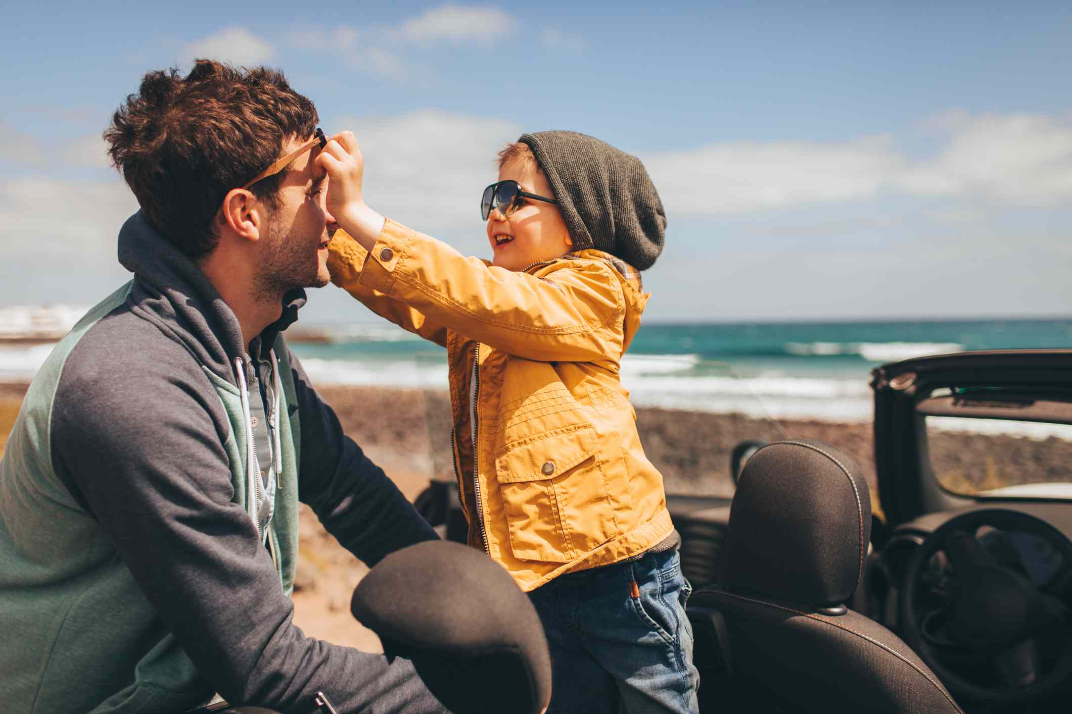 man and child wear sunglasses outside