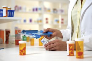 Pharmacist filling perscriptions