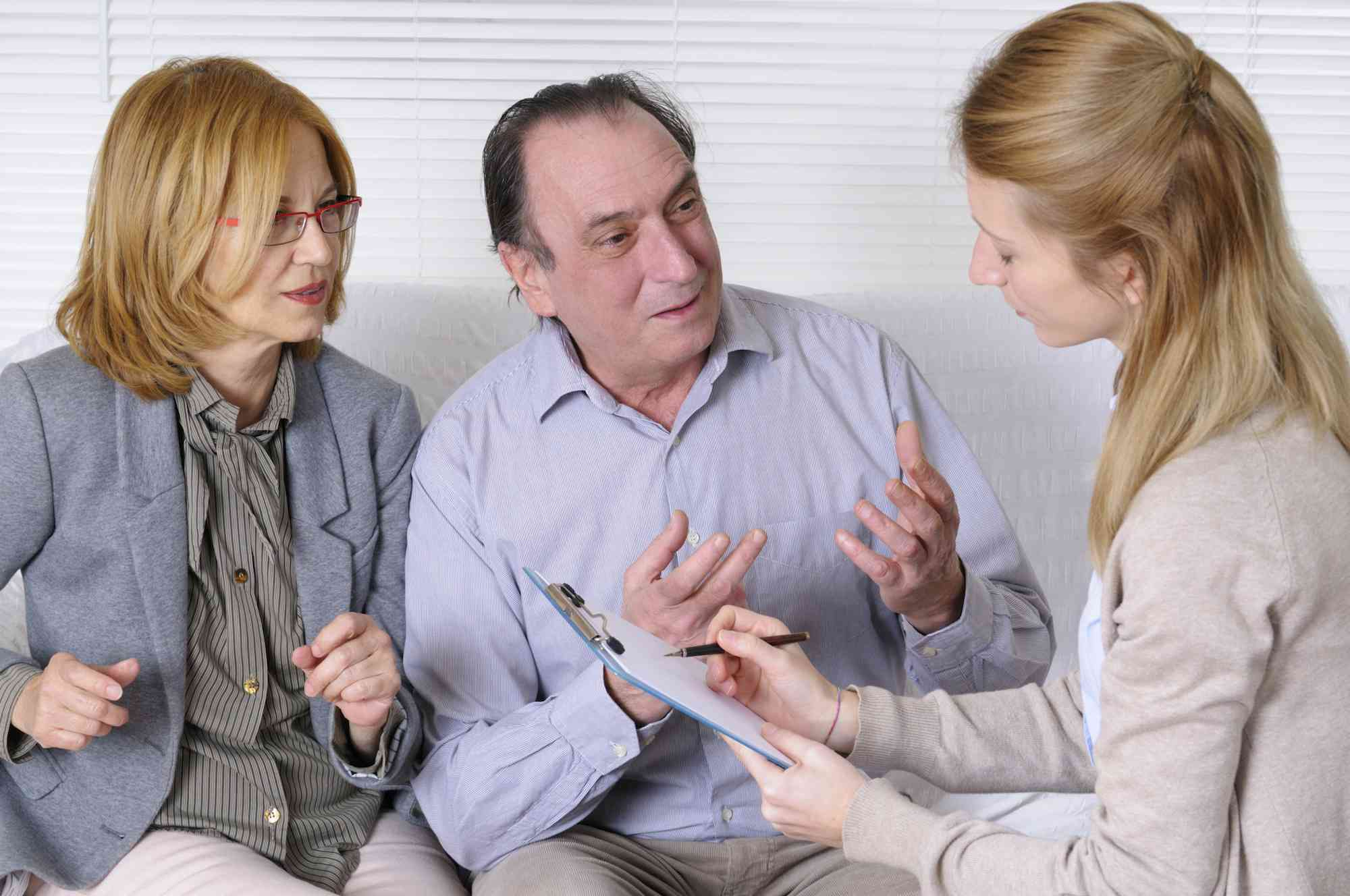 A couple and a counselor talking about their medical standing