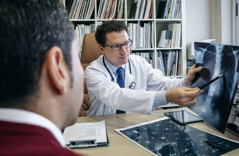 Doctor showing x-ray image to patient