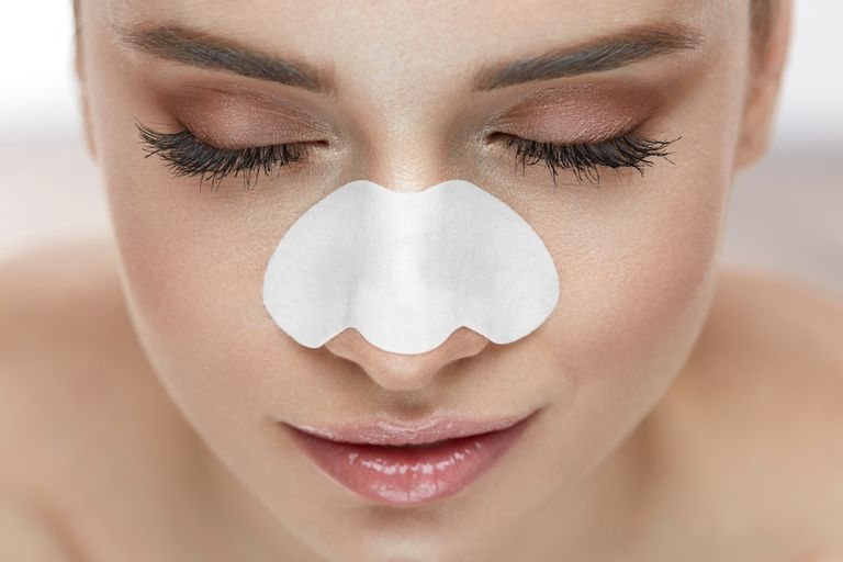 Beautiful Woman Face With Skin Care Patch On Nose