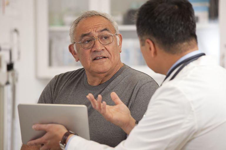 Older patient talking with his doctor