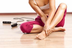 A woman massaging her sore foot