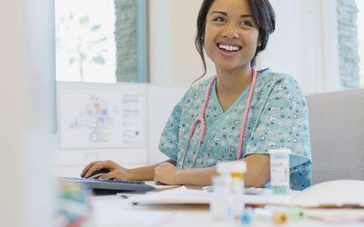 Happy female nurse looking away