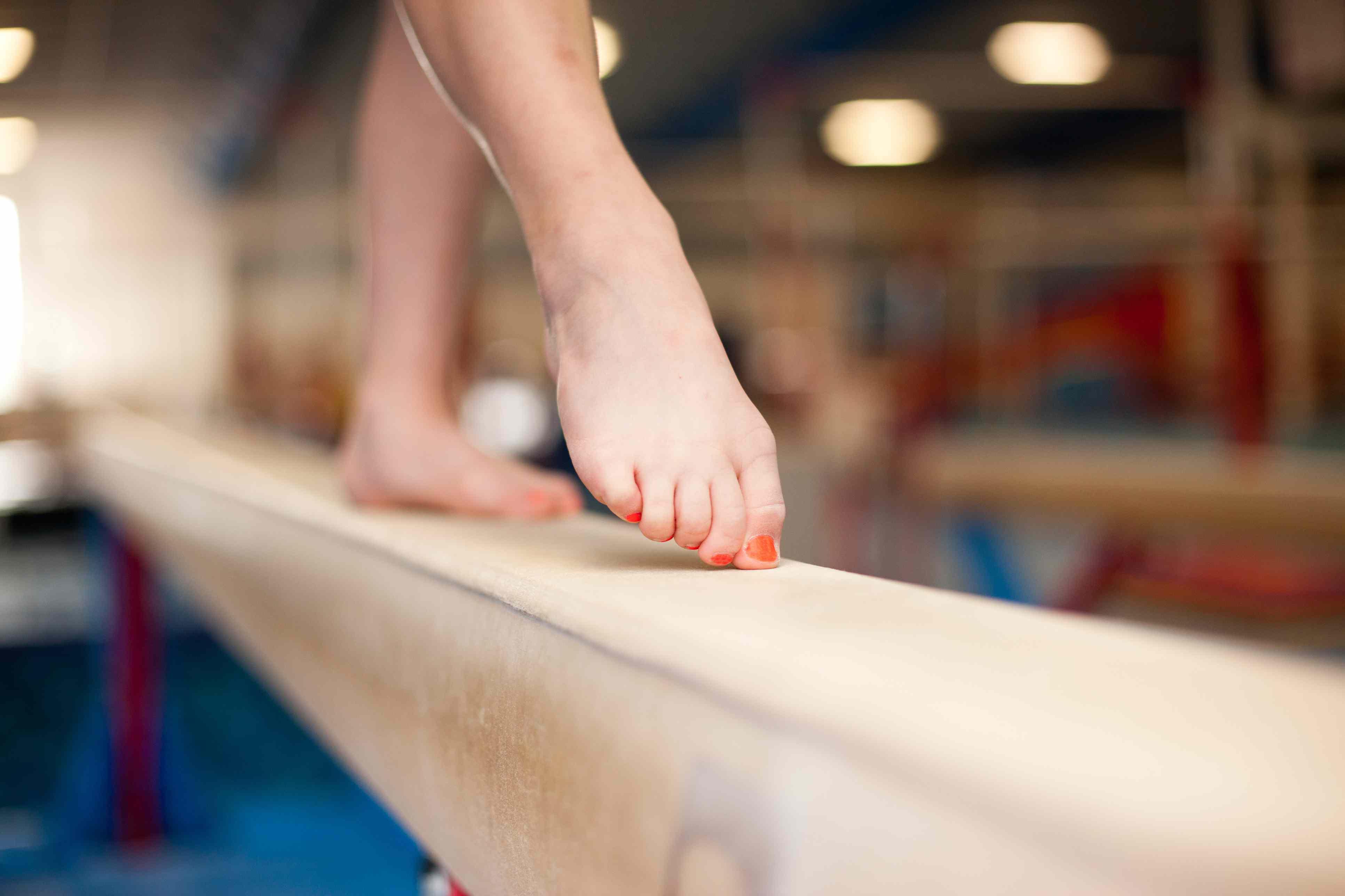 Young Gymnast Toes on Balance Beam