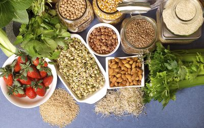 A table of nuts, fruits, and grains