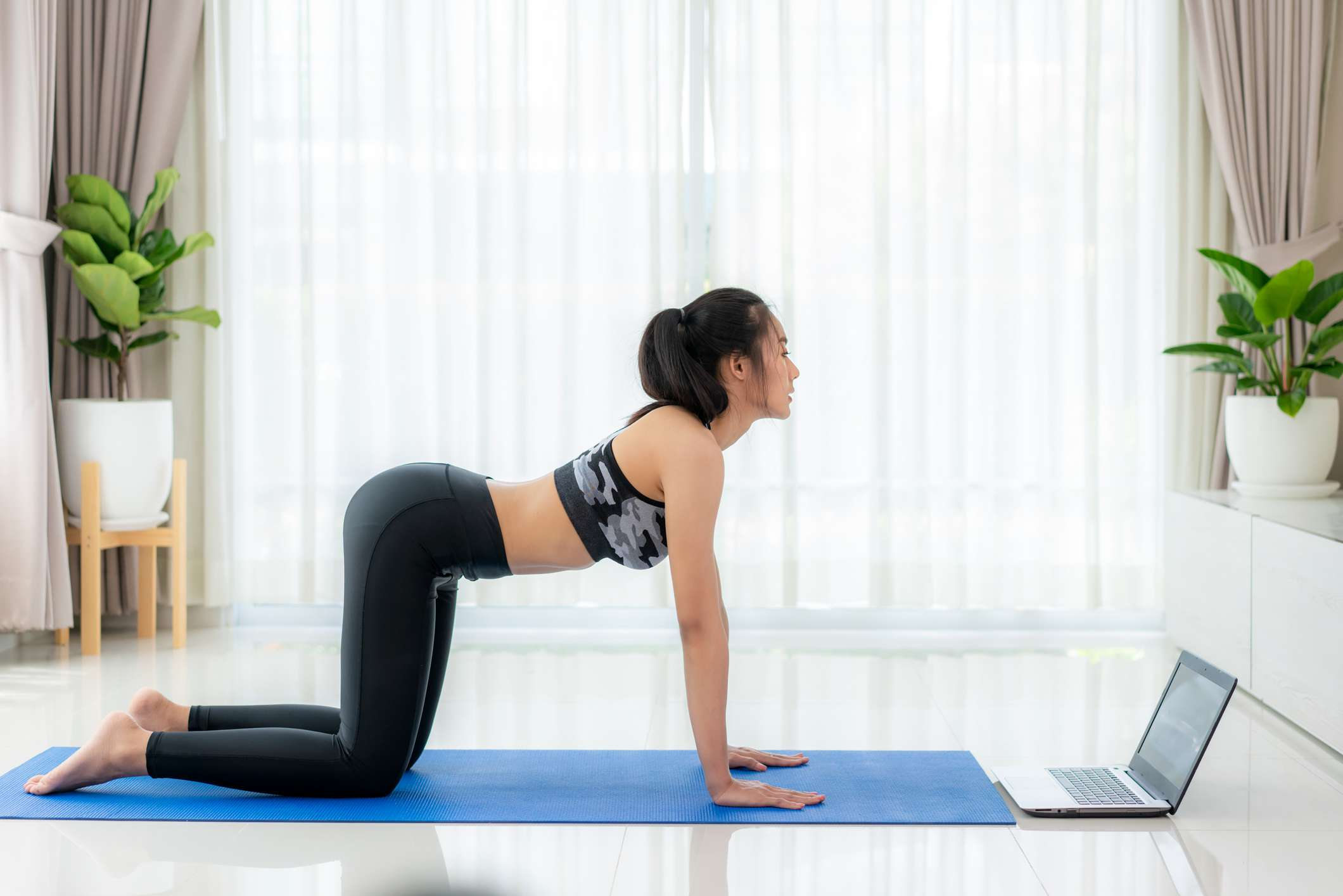 Woman does yoga pose