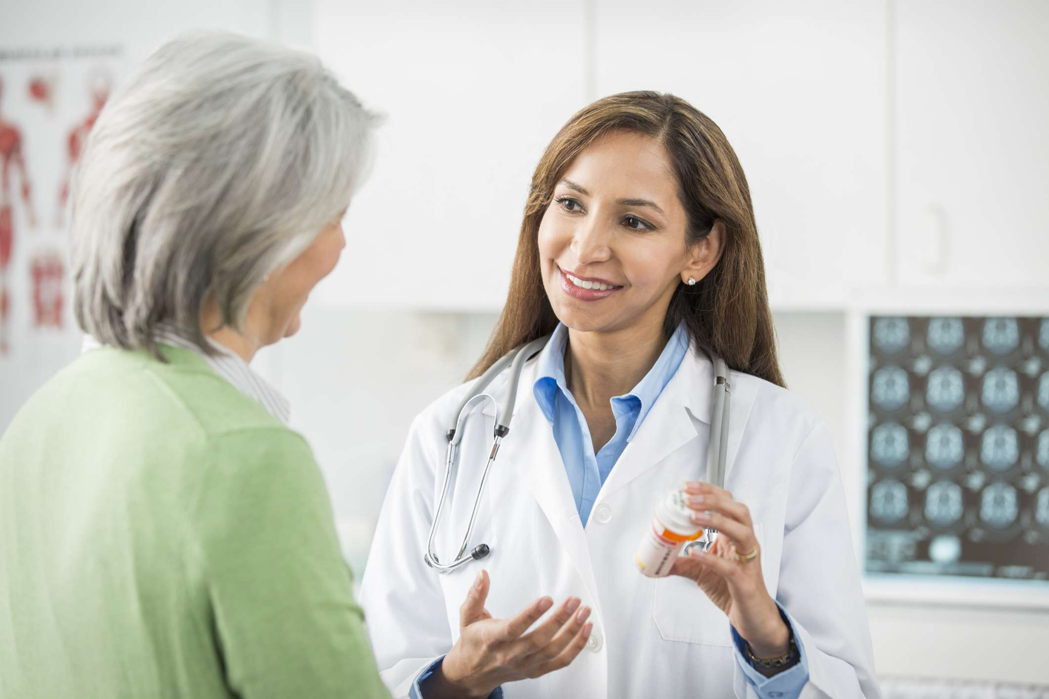 Woman talking with the Doctor in her office