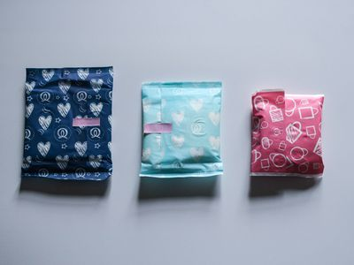 Photo of three different sized wrapped menstrual pads