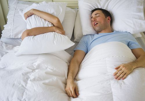 Man snores loudly due to position because sleeping on the back can cause snoring