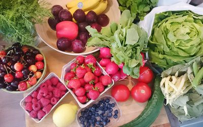 Assorted vegetables and fruit on a kitchen counter