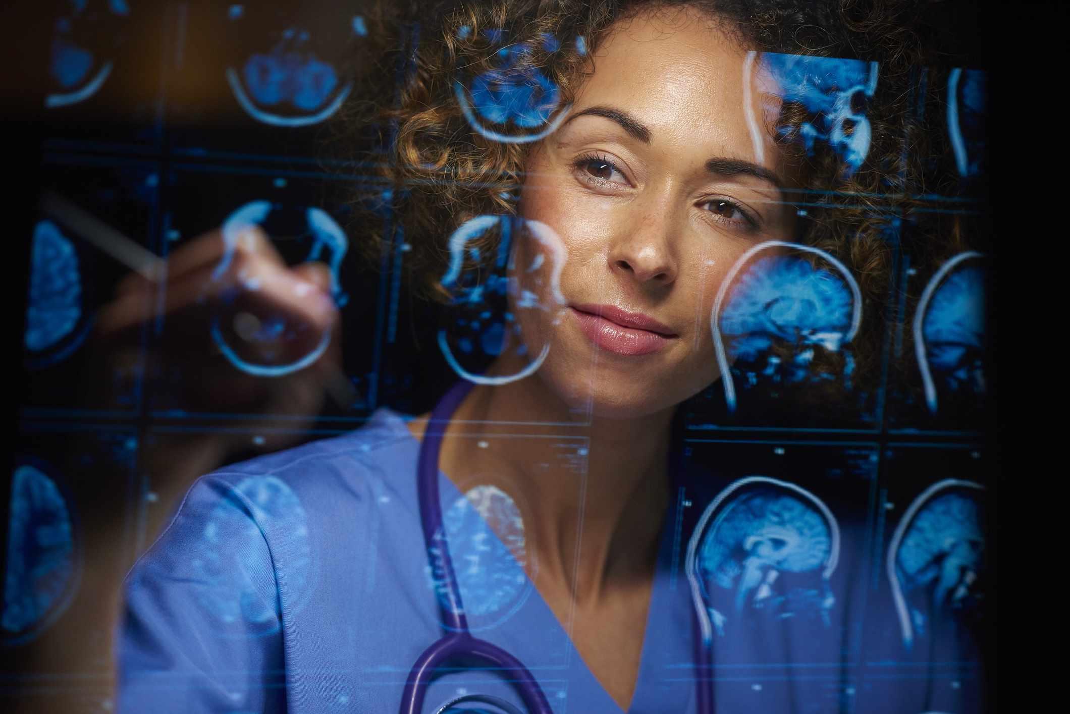neurosurgeon checking mri scans
