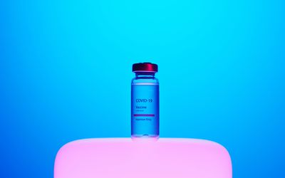 A stylistic still life shot of a vial labeled