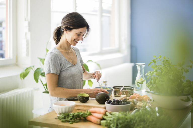 Woman preparing healthy food in her kitchen