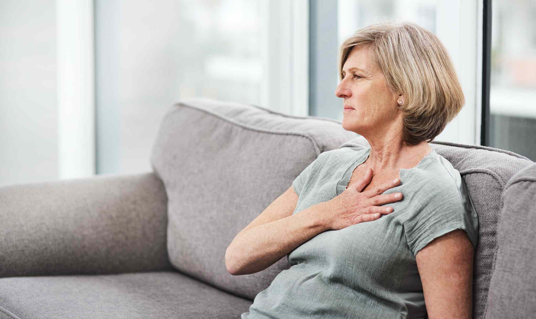 a woman who is having trouble breathing