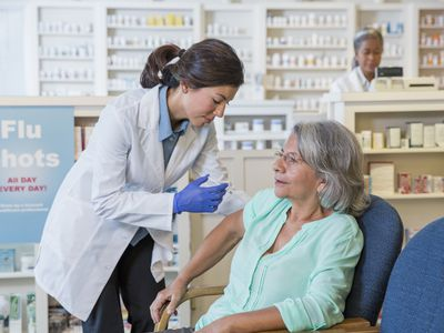 Older woman getting a flu shot