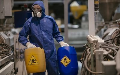 Factory worker working with dangerous materials