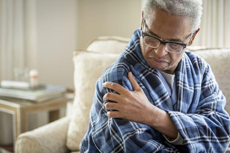 senior man rubbing shoulder