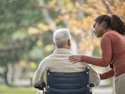 Caregiver and man in wheelchair