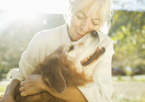 woman and her dog experiencing the benefits of