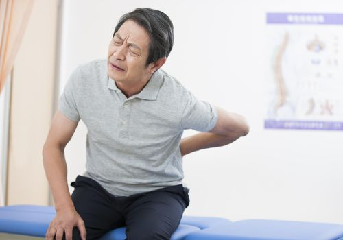 Senior patient suffering from backache