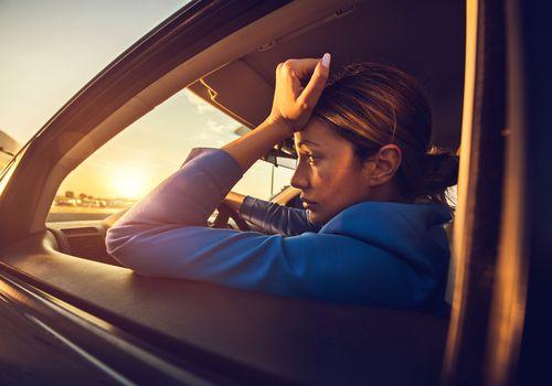 Sad woman in a car.
