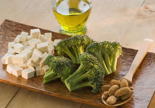 broccoli, tofu, almonds displayed on tray