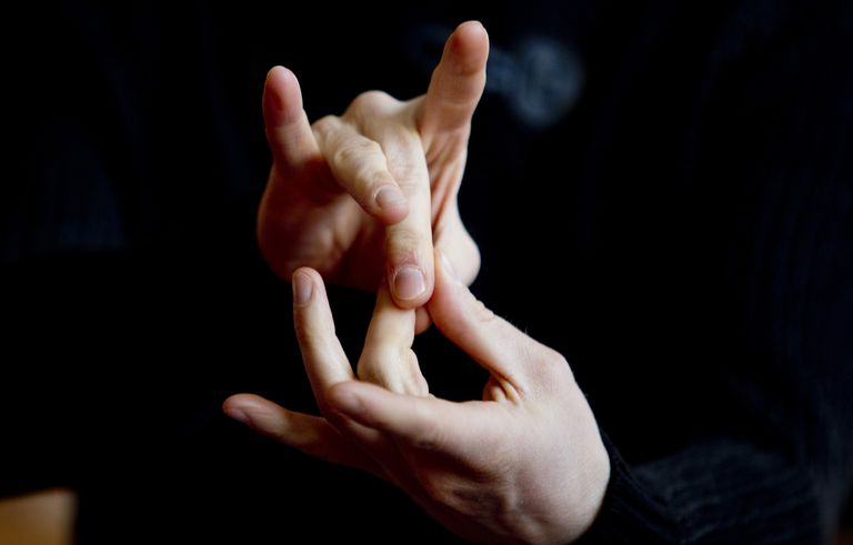 a person using sign language.