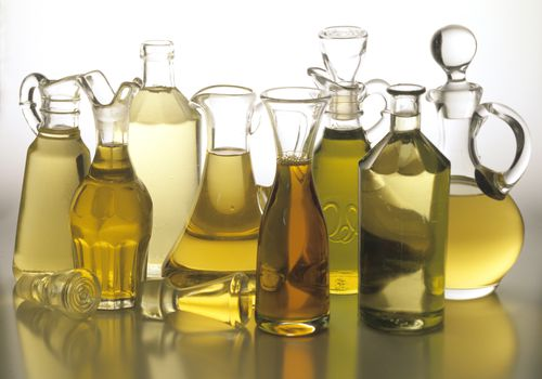 various cooking oils in glass containers