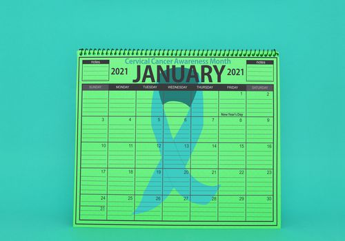 Illustration of a green January 2021 calendar with a teal ribbon for cervical cancer awareness month on a teal background