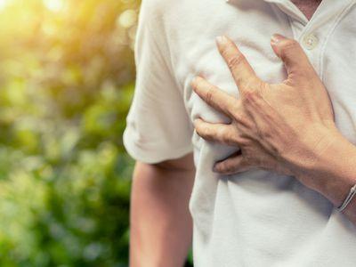 Hand clutching heart