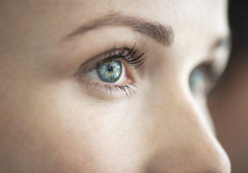 A green-eyes woman looking forward