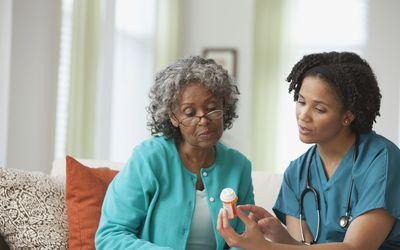 Nurse going over prescription with patient